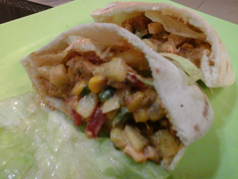 Healthy and tasty pita sandwich stuffed with chicken and veggies