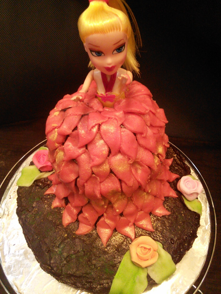 Vanilla Cake covered in chocolate ganache and molded to look like a princess...