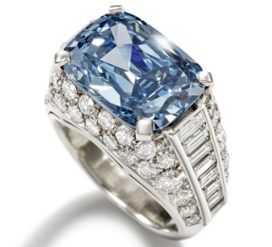 Worlds Most Expensive Engagement Ring Blue Diamond. The Stone is guarded by brilliant cut diamonds and baguette cut diamonds along the sides of the ring.