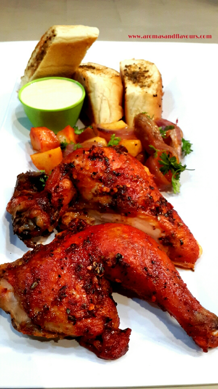 Peri Peri chicken with Musk Melon dip, roasted potatoes, caramelized onions and garlic bread